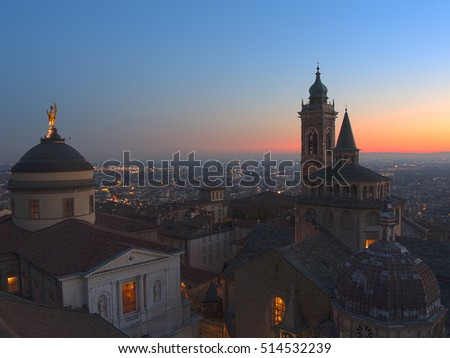 Bergamo - Old city (Citta Alta). One of the beautiful city in Italy. Lombardia. Evening sunset. Landscape on the old city, Cathedral, clock towers and the Po Valley.
