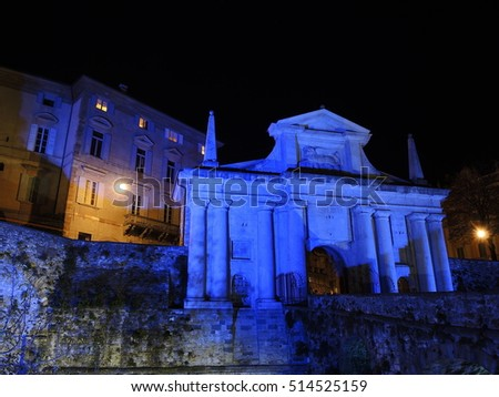 Bergamo - Old city (Citta Alta). One of the beautiful city in Italy. Lombardia. Landscape on the old gate named Porta San Giacomo during night lighted in blue color