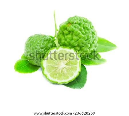 Bergamot fruit with leaf on white background - stock photo