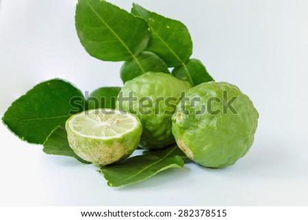 Bergamot fruit with  leaves on white background - stock photo