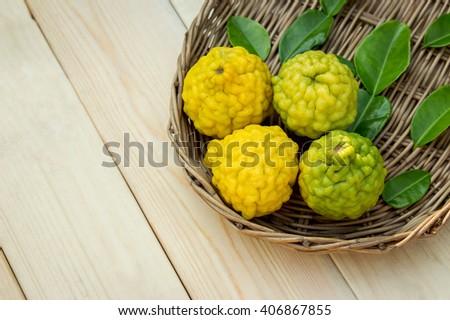 bergamot fruits in wooden basket. herbs for healthy living.  - stock photo