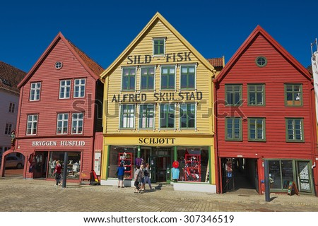 BERGEN, NORWAY - JUNE 06, 2010: Unidentified people walk at Bryggen in Bergen, Norway. Bryggen is a UNESCO world Heritge site.