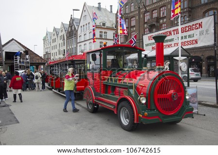 BERGEN, NORWAY - MAY 8: A road train in Bergen, Norway, on  May 8, 2012. The driver and some passengers wait to depart on a tour of the city from the UNESCO World Heritage Site, Bryggen. - stock photo