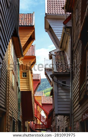 BERGEN, NORWAY - MAY 19, 2014: Colorful wooden houses in the UNESCO World Heritage Site, Bryggen, in the city of Bergen. Bryggen is also known as the Tyskebryggen. - stock photo