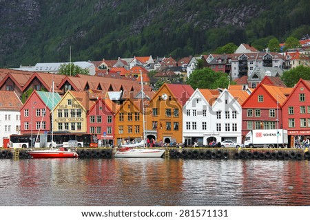 BERGEN, NORWAY - MAY 19, 2014: Colorful wooden houses in the UNESCO World Heritage Site, Bryggen, in Bergen. Bryggen is also known as Tyskebryggen. The view from the other side of the Fjord. - stock photo