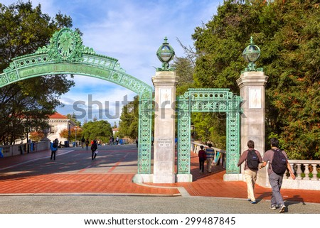 BERKELEY, CA-DEC 8, 2014: University of California at Berkeley at the main entrance into the campus. Students are shown walking under the ornate passageway, called Sather Gate, built in 1910.  - stock photo