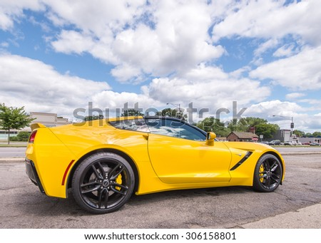 BERKLEY, MI/USA - AUGUST 12, 2015: A 2014 Chevrolet Corvette, at the Woodward Dream Cruise. Woodward is a National Scenic Byway. - stock photo