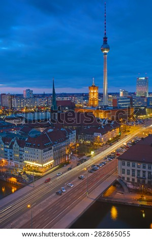 Berlin Alexanderplatz with the famous television tower at night - stock photo
