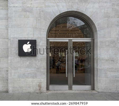 BERLIN - APRIL 14: Facade detail with Apple logo at the Apple Store on Kurfuerstendamm. Apple is dealing in computers and innovative consumer electronics, April 14, 2015, Berlin, Germany - stock photo