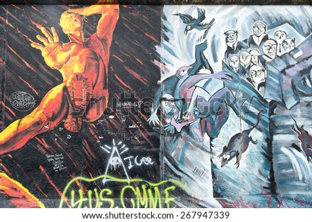 BERLIN, APRIL 01: Graffiti at the East Side Gallery on April 01, 2015 in Berlin, Germany. The East Side Gallery is the longest preserved stretch of the Berlin wall.  - stock photo