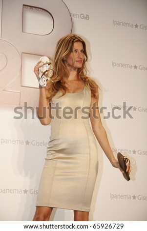 BERLIN - APRIL 29: Model Gisele Buendchen  poses with her line of Ipanema G2B sandals at the Adlon Hotel in Berlin, Germany. April 29 2008, Berlin