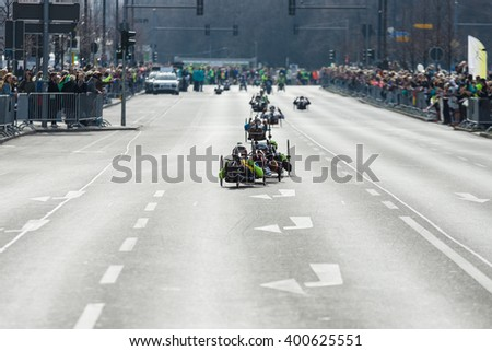 BERLIN - APRIL 03, 2016: The annual Berlin Half Marathon. Race through the city streets. Athletes of disabled in wheelchairs.