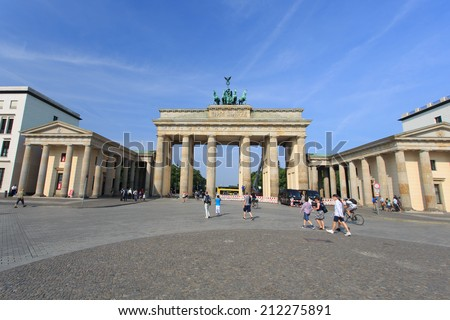 BERLIN - AUG 07: Brandenburg Gate at Aug 07, 2014 in Berlin, Germany - The Brandenburg Gate is one of Berlin's most important monuments, a landmark and symbol all in one with over 200 years of history