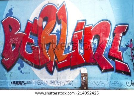 BERLIN - AUGUST 24, 2014 : The East Side Gallery is the largest outdoor art gallery in the world. This is a graffiti of the letters Berlin. - stock photo