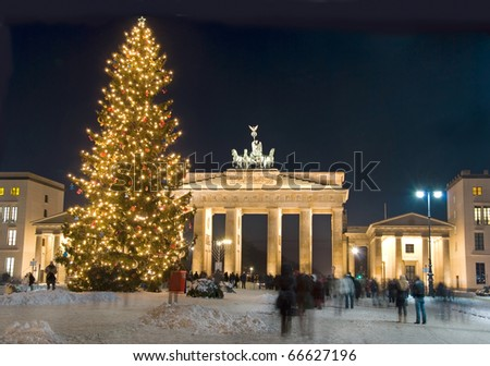 berlin brandenburg gate with christmas tree and snow - stock photo
