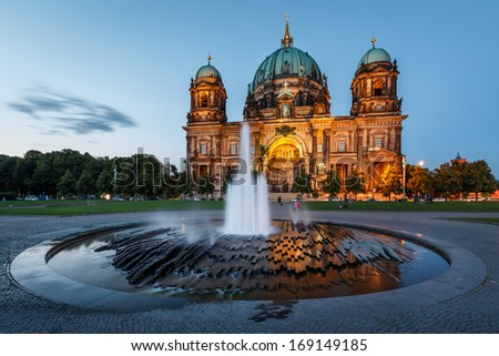 Berlin Cathedral (Berliner Dom) and Fountain Illuminated in the Evening, Germany - stock photo
