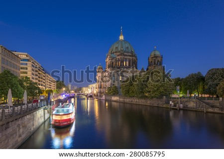 Berlin Cathedral (Berliner Dom) on Museum Island (Museumsinsel) and tour boat on Spree River at evening, Berlin Mitte, Germany, Europe  - stock photo
