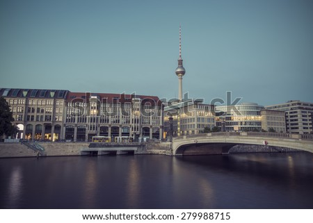 Berlin Cityscape, TV Tower and bridge (Friedrichsbruecke) over river Spree at evening, Berlin Mitte, Germany, Europe, vintage filtered style - stock photo