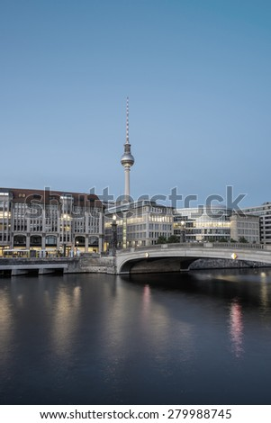 Berlin Cityscape, TV Tower and bridge (Friedrichsbruecke) over river Spree at evening, Berlin Mitte, Germany, Europe, filtered style - stock photo