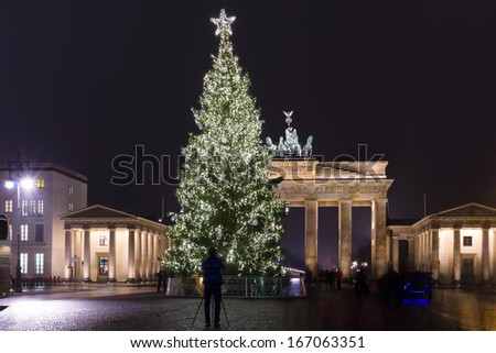 BERLIN - DECEMBER 10: Brandenburg Gate and the Christmas tree, December 10, 2013 in Berlin, Germany. Brandenburg Gate - the symbol of Germany.