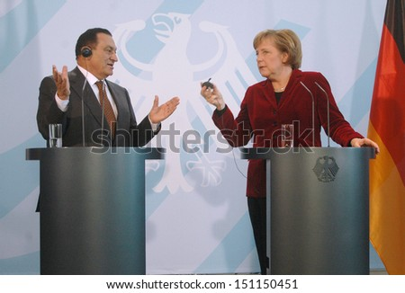 BERLIN - DECEMBER 10: Egyptian President Hosni Mubarak argues with German Chancellor Angela Merkel  during a meeting in the German Chanclery in Berlin, December 10, 2006. - stock photo
