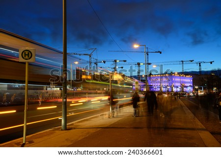 BERLIN - DECEMBER 26: Night traffic on 26 December 2014 in Berlin, Germany. With a population of 3.5 million people, Berlin is Germany's largest city. - stock photo