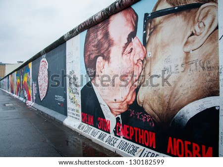BERLIN - FEBRUARY  20: Kiss between Brezhnev and Honecker painting on Berlin Wall at East Side Gallery February 20, 2013 in Berlin - stock photo