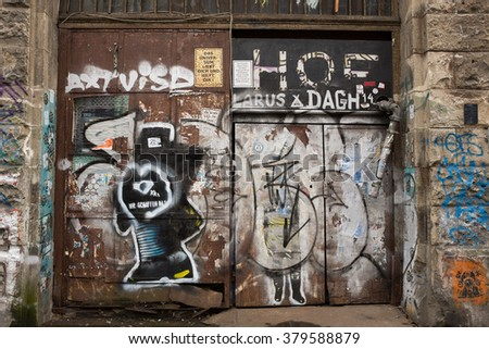 BERLIN - FEBRUARY 18: Original building door with old posters in the Tacheles, Oranienburgerstrasse in Berlin on February 18, 2016. A symbol of the trash and grunge style after the wall fall in Berlin