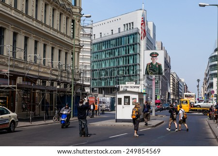 BERLIN, GERMANY - APRIL 14: Checkpoint Charlie in Berlin on April 14, 2009. The name was  given by the Western Allies to the best-known Berlin Wall crossing point between East Berlin and West Berlin. - stock photo