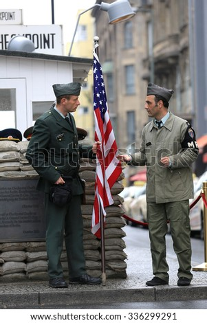 Berlin, Germany - April 27, 2015: Checkpoint Charlie was the name given by the Western Allies to the best-known Berlin Wall crossing point between East Berlin and West Berlin during the Cold War.