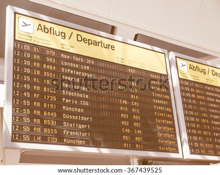 BERLIN, GERMANY - APRIL 26, 2010: Flight departures timetable in Berlin airport showing international and national flights vintage