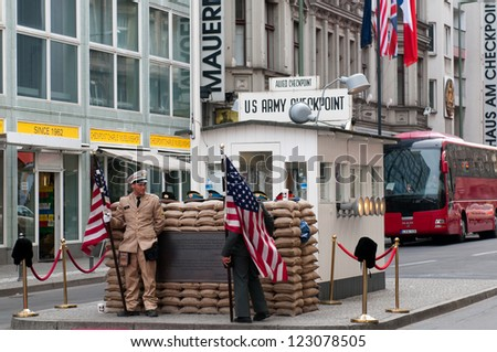 "BERLIN, GERMANY - APRIL 15: Former bordercross checkpoint ""Point Charlie"" in Berlin on April 14, 2012. It's the best-known Berlin Wall crossing point between East and West Berlin during the Cold War. - stock photo"