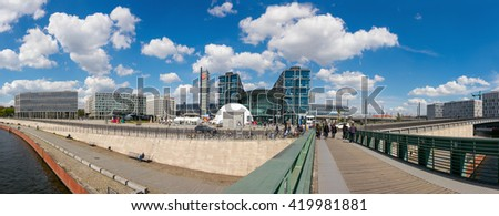 BERLIN, GERMANY - APRIL 29, 2016: Panorama of Berlin Central Station and nearby buildings. Daily number of passengers at Berlin Hauptbahnhof is estimated to be at 350,000. - stock photo