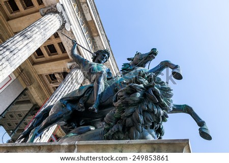 BERLIN, GERMANY - APRIL 13: The Gendarmenmarkt is a square in Berlin on April 13, 2009. Located at this square is the Konzerthaus (concert hall), the German Cathedral and French Cathedral.  - stock photo