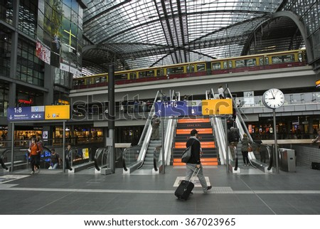 BERLIN, GERMANY - AUGUST 25, 2013: Berlin Hauptbahnhof, the main railway station in Berlin, welcomes an estimated 350,000 passengers traveling on 1,800 trains each day, Berlin, Germany, Aug.25, 2013. - stock photo