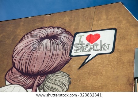 "BERLIN, GERMANY - AUGUST 6 2015: Berlin Wall graffiti ""I love Berlin"". The East Side Gallery is an international memorial for freedom. It is a 1.3 km long section of the Berlin Wall - stock photo"