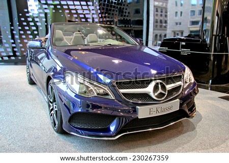 BERLIN, GERMANY - AUGUST 16, 2014: Brand new car Mercedes-Benz C207 E-class in the Mercedes-Benz showroom. - stock photo