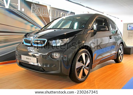 BERLIN, GERMANY - AUGUST 16, 2014: Brand new electric vehicle BMW i3 in the showroom of the BMW Haus am Kurfuerstendamm. - stock photo