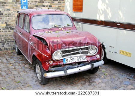 BERLIN, GERMANY - AUGUST 12, 2014: Crashed retro vehicle Renault 4 in the museum of vintage cars Classic Remise. - stock photo