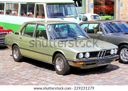 BERLIN, GERMANY - AUGUST 12, 2014: German classic sedan BMW E12 528 in the museum of vintage cars Classic Remise. - stock photo