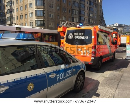 Berlin, Germany - August 9, 2017: German national police car and fire department service truck. 112 is the European emergency number that can be dialed free of charge for fire and medical emergency