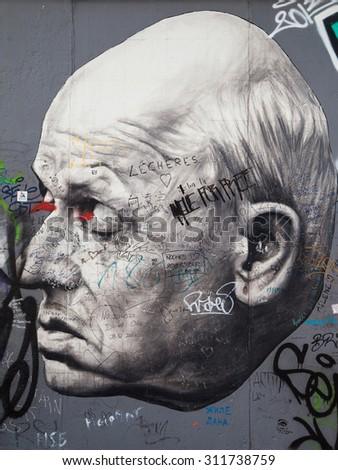 BERLIN, GERMANY - AUGUST 8: Mural 'Danke Andrej Sacharow' by Dimitri Vrubel on the East Side Gallery, the longest preserved stretch of the wall, on August 8, 2015 in Berlin, Germany.
