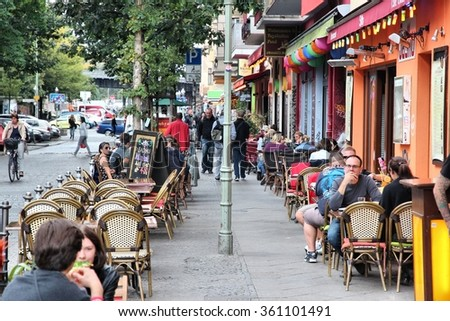BERLIN, GERMANY - AUGUST 26, 2014: People dine out in Wrangelkiez area of Kreuzberg district in Berlin. 11.3 million guests visited Berlin in 2014. - stock photo