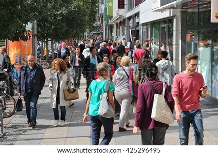 BERLIN, GERMANY - AUGUST 27, 2014: People shop at Tauentzienstrasse in Berlin. Berlin is Germany's largest city with population of 3.5 million.
