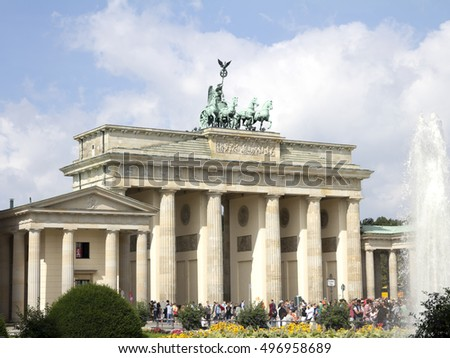 BERLIN, GERMANY - AUGUST 13, 2016: Tourists in front of the Brandenburg Gate.