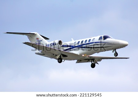 BERLIN, GERMANY - AUGUST 17, 2014: WinAir Cessna 525A Citation arrives at the Tegel International Airport. - stock photo