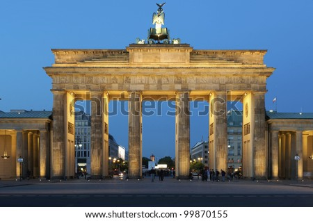 Berlin, Germany -  Brandenburg Gate in Berlin once one of the iconic locations in the division of East and West German. The Berlin Wall ran around the place in front of the gate - stock photo