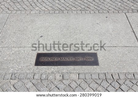 Berlin, Germany. Capital city landmark - former Berlin Wall location is marked on the pavement. - stock photo