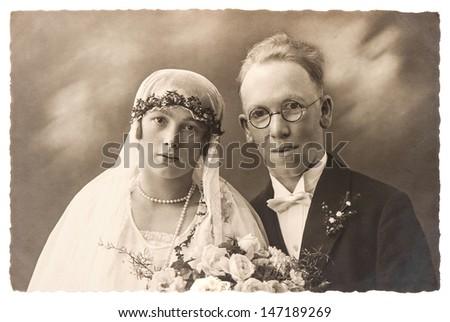 BERLIN, GERMANY - CIRCA 1920: original antique wedding photo. portrait of just married couple. nostalgic picture, circa 1920 in Berlin, Germany - stock photo