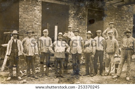 BERLIN, GERMANY, CIRCA 1930's: Vintage photo of group of workmen outdoor - stock photo